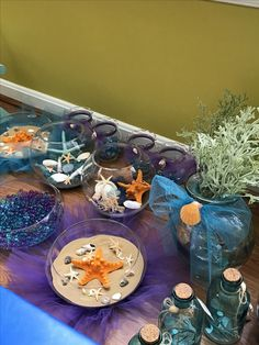 Assorted centerpieces and glass bowl decor.  Seashells Starfish Waterbeads Sand  Made for a under the sea Mermaid baby shower.