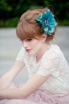 interesting idea of having a white dress, but a colored accent in the hair