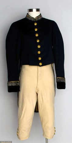 """AMERICAN SUIT WORN AT FRENCH COURT, 1840 1 black wool broad cloth tailcoat, velvet cuffs & band collar w/ gold embroidery, 8 CF & 2 back buttons each inscribed """"Honi soit qui mal y pense"""", Ch 38"""", CF L 18"""", CB L 36"""", (some wear to velvet on collar) excellent; 1 pair white wool breeches, watch po buttons & brass buckle at knee, W 31"""", Inseam 17"""", very good. Provenance William Shimmin, Mass."""