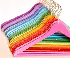 Rainbow Hangers. Cute for organizing clothes by having each person a certain color:)