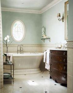 Pedestal Tub. White tile floor with black small design