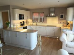 Recently fitted kitchen in Wall Heath, Kingswinford. Gloss ivory slab doors with curved units, and Neff appliances gives a modern yet warm feel. Living Room Kitchen, Home Decor Kitchen, New Kitchen, Home Kitchens, Kitchen Ideas, Kitchen Units, Kitchen Layout, Kitchen Design, Ivory Kitchen