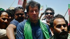 Cricket legend and politician Imran Khan (C) is surrounded by his supporters during a campaign rally in Karachi. (Source: AFP)