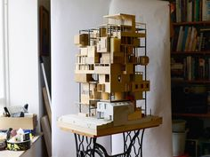 'a model' seeks to create an architecture which reflects the dreams of many