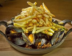 The Chorizo Roasted Mussels with Fries at French Blue restaurant in St. Helena, Calif., is seen on Friday, August 10th, 2012. Photo: John Storey, Special To The Chronicle / SF
