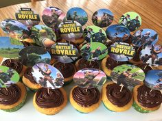 I made these Fortnite cupcakes for my son's 13th birthday party. Cupcakes are decorated with custom made paper cupcake toppers. They were a big hit.