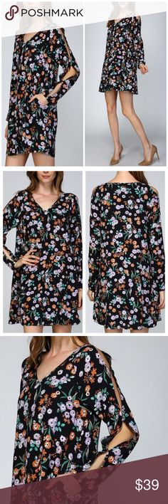Garden Floral Split Sleeve Dress Garden Floral Split Sleeve A-Line Dress Woven V neck A line dress All over floral print Raglans style full length sleeves are split at top held together at 3 points Real shell button closure at sleeve cuffs Side seam pockets on either side Fully lined 100% rayon Lining is 100% polyester Boutique Dresses