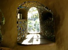 This is the tiny window providing a Zen view from the cob home built by Ziggy at the Dancing Rabbit ecoVillage: www.small-scale.net/yearofmud/