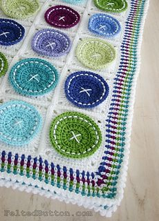 Felted Button: Pattern on sale in Ravelry. Like the embelishments of the buttons on this blanket - clever idea.