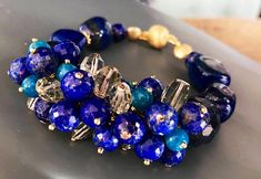 Blue bracelet with Lapis Lazuli, Fluorite, Green Amethyst, Aventurine and Vermeil claps and findings.