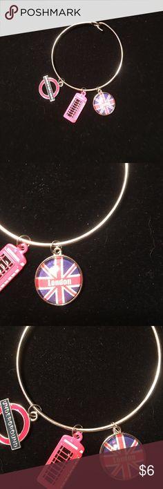 Silver bracelet with London theme charms Silver bracelet with 3 London theme charms. NWOT Jewelry Bracelets