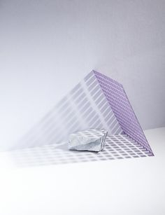 Matt Graham: Artist used symmetrical shapes around an A-symetrical object.GEOMETRIC SHAPES AROUND AN ORGANIC SHAPE