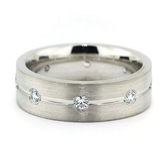 Handsome satin finish and diamond men's wedding band. The unique style is different yet timeless. A band that will last forever! Band Name: Walk the Line Width: 6 mm Finish: Satin Accent Stones Trade