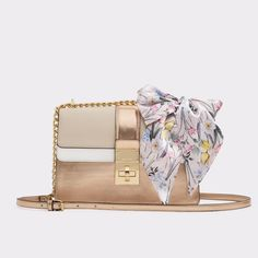 0394b7088ec Cerano Sweet florals pair with structured hardware on this structured cross  body bag. Bow detailing