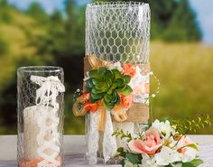 Glass cylinder wrapped with chicken wire, burlap, succulent