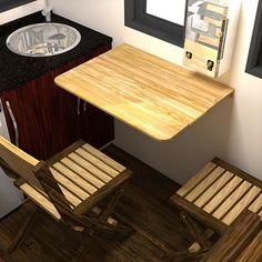 The Nook: Really Small And Easy to Tow Tiny House Plans: Tiny KItchen with fold-down table and folding chairs that store overhead.