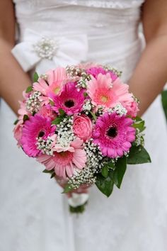 Lovely dark pink and light pink bridal bouquet of pink gerbera flowers with baby's breath Gerbera Wedding Bouquets, Gerbera Daisy Bouquet, Prom Bouquet, Bridal Bouquet Pink, Wedding Flower Arrangements, Pink Gerbera, Gerbera Daisies, Flower Bouquets, Floral Arrangements