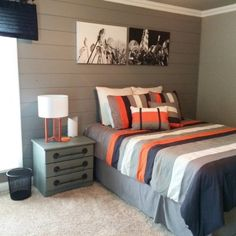 Planked wall, gray painted dresser and night stand with industrial style hardware added