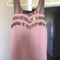 Dressy Tank top. Mauve in color with gold/bronze sequence. Never been worn. Tags still attached. Very cute on with a pair of jean or even with dress pants. Buckle Tops Tank Tops
