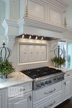 White kitchen with decorative backsplash design