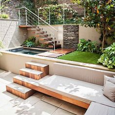 Completely over budget and much more grade change than I need, but these backyard steps once again integrate the main grade change into an adjacent use. At the upper level it becomes a waterfall and at the lower level a step becomes a bench and the higher grade becomes the seatback. Brava.