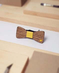 Wooden Bow Tie Paris Yellow  ♠ Enjoy this fun accessory that will fit your favorite shirt, blazer and best mood. Add an original accent to your style and break up your routine. Easy to wear and totally easy to impress!  ♠ Uniqueness This item will be made especially for you upon ordering. Due to materials and handwork specifics the purchased item may look slightly different than the one on the photos.  ♠ Size and Materials 4.5 x 1.7 | 11.5 x 4.5 cm Base: Wood Finish: Varnish Knot: Leather…