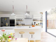 Lindsey and Chris Reed knocked three rooms together and extended to create an open-plan  kitchen diner and living room that maximises garden views