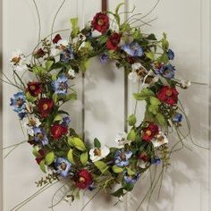 Americana Wreath by TAPSCOTTS. $49.95. A delicate arrangement of paper flowers makes our Americana Wreath a must-have for any home that appreciates floral wall decor. Pretty field flowers colored white, shades of blue, periwinkle, and red, decorate this festive handcrafted wreath. Permanent bright green leaves give this wall or door accent some flare too, and allow the wreath to not have such a strict red, white, and blue feel. A spiral of faux twigs branch out f...