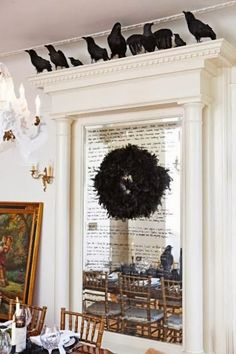 On the blog today - IT'S NOT TOO LATE - LAST MINUTE HALLOWEEN IDEAS - LOVE this faux crows crowning an elaborate mirror marked with a spooky poem - #FocalPointStyling #Halloween