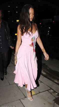 Pretty in pink: The 28-year-old singer showed off her girly side in a flirty pink dress with a full skirt and spaghetti straps