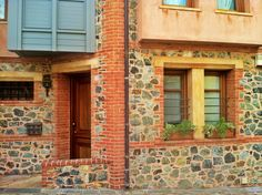 A modern house that makes use of all the traditional elements found in the older buildings of Thessaloniki: red brick, stone and wood. (Walking Thessaloniki, Route Upper Town c) Old Building, Red Bricks, Thessaloniki, Buildings, Old Things, Walking, Traditional, Stone, Architecture