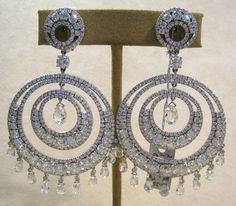 Earrings- Double hoop diamonds glimmering in at over 40 carats!
