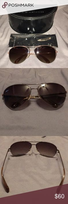 Marc By Marc Jacobs Sunglasses EUC with no scratches aviator style sunglasses in brown metal sunglasses. These run a little too small for my face since I have chubbier cheeks so they create a line which I don't like. It comes with the case and cleaning cloth. The cleaning cloth has never been used. No scratches on the lenses at all. No wear on the arms either. The Specks in the picture looks like dust or glare from the flash. Marc By Marc Jacobs Accessories Glasses