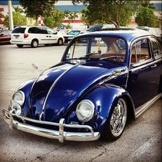 My '67 Bug, converted to a '66 looker. Paint is Maserati Blue Oceano by BASF Glasurit.
