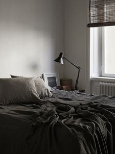 Loving the dark, moody colour palette in this bedroom, its a great way to show how dark colours can be used in a bedroom!