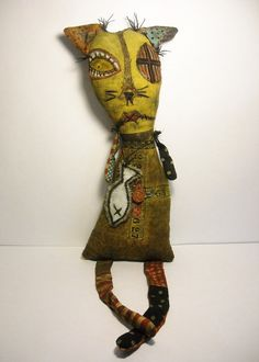 Mangy Marge is a one of a kind primitive art doll. She is made with a mix of new and recycled fabrics and parts. She is stained and partially painted