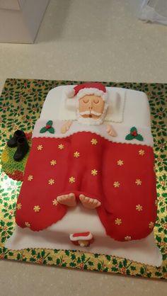 Fondant santa in bed cake
