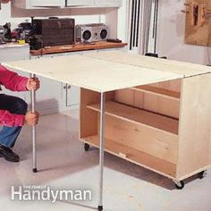 to Build a Compact Folding Workbench with Storage This is a great space saver for a small garage! Folding Workbench: The Family HandymanThis is a great space saver for a small garage! Folding Workbench: The Family Handyman Making A Workbench, Workbench With Storage, Folding Workbench, Workbench Plans, Garage Workbench, Workbench Organization, Workbench Designs, Folding Sewing Table, Table Storage