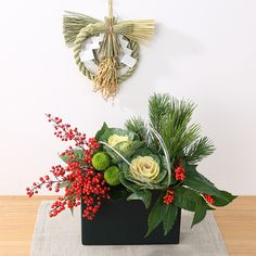 muji new year's flower arrangment 松と葉牡丹のお正月アレンジ                                                                                                                                                                                 もっと見る Flower Centerpieces, Christmas Flower Arrangements, Christmas Flowers, Christmas Centerpieces, Flower Decorations, Noel Christmas, Christmas Wreaths, Ikebana Arrangements, Floral Arrangements