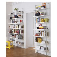 Shop stairway white ladder bookcase.   Minimalism scales to the max in clean, pristine white.  Seven shelves ladder sky high (a CB2 record high at 8 feet) in engineered wood with hi-gloss lacquer.