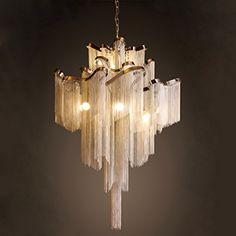 Take the mystical feelings associated with Atlantis, and place them in your home - in the form of a flowing, aluminum tassel chandelier! This chandelier is dressed up in hundreds of little aluminum ta Art Deco Chandelier, Luxury Chandelier, Candle Chandelier, Modern Chandelier, Chandelier Lighting, Modern Lighting, Stairway Lighting, Round Chandelier, Luxury Lighting