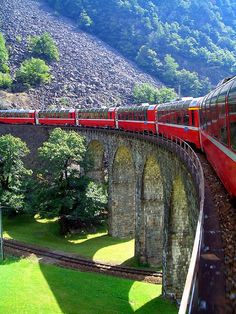 Bernina train on Brusio viaduct in Graubünden, Switzerland (by Awesome trip. Road this train in By Train, Train Tracks, Train Rides, Ways To Travel, Places To Travel, Places To See, Travel Hacks, Travel Destinations, Travel Tips