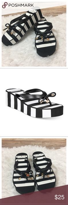 "NWOB Kate Spade Rhett Stripe Wedge Sandals NWOB Kate Spade Rhett Stripe Wedge Flip Flop Sandals - Black/White  Bold stripes add an arresting accent to jeans, shorts and skirts in kate spade new york's Rhett wedge flip-flops.  - Round open-toe slip-on thong platform wedge flip-flop sandals with bow detail. - 2"" wedge heel, 1"" platform - Rubber upper; manmade sole - Size 6 - Brand new never worn - No box  No TRADES. Please use offer button to negotiate. Thanks! kate spade Shoes Sandals"