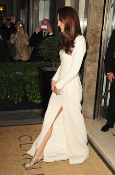 Catherine, Duchess of Cambridge, attends a black tie event at the Thirty Club in London in a Roland Mouret gown paired with Jimmy Choo sandals.