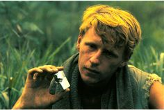 """H Co, 2d Battalion, 5th Marines, Ernst Woodruff, 1969  """"Lance Corporal Ernst Woodruff, a German national and machine gunner in H/2/5, holds his Zippo lighter after it had been hit by a piece of shrapnel while in his pocket, Quang Nam, 1969. Woodruff was not harmed.""""   From the Barry Broman Collection (COLL/4613) at the Archives Branch, Marine Corps History Division   OFFICIAL USMC PHOTOGRAPH"""