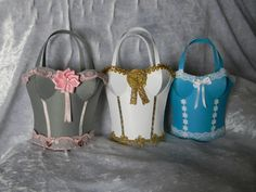 Corsets in grey, white and blue