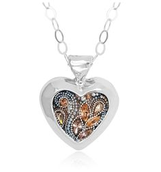 A glamorous mix of marquise-cut stones and vibrant pearl accents, this pendant will announce to the world that you're all heart. It combines soft peach and champagne colored Swarovski crystals with a spray of pearl beads that add fresh color and simple, easygoing style to the design. For added femininity, this beautifully polished sterling silver heart-shaped bezel hangs from an open link silver chain.