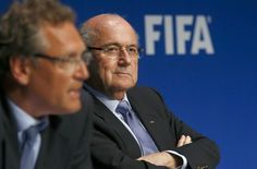 FIFA President Sepp Blatter listens to secretary general Jerome Valcke (L) during a news conference after a meeting of the FIFA executive committee in Zurich March 20, 2015. REUTERS/Arnd Wiegmann