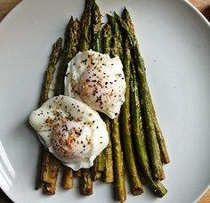 poached eggs and pan sauteed asparagus with garlic, salt and pepper