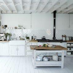 windows where their drywall is - whitewashed floors, wood counters, subway backsplash